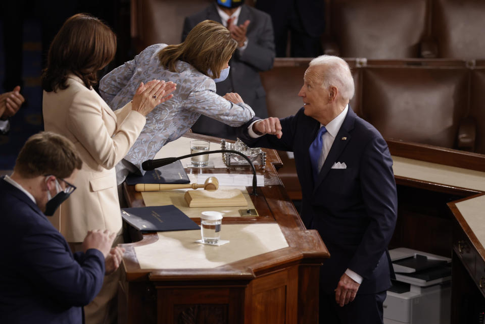 President Joe Biden elbow bumps House Speaker Nancy Pelosi after he addressed a joint session of Congress, Wednesday, April 28, 2021, in the House Chamber at the U.S. Capitol in Washington. (Jonathan Ernst/Pool via AP)