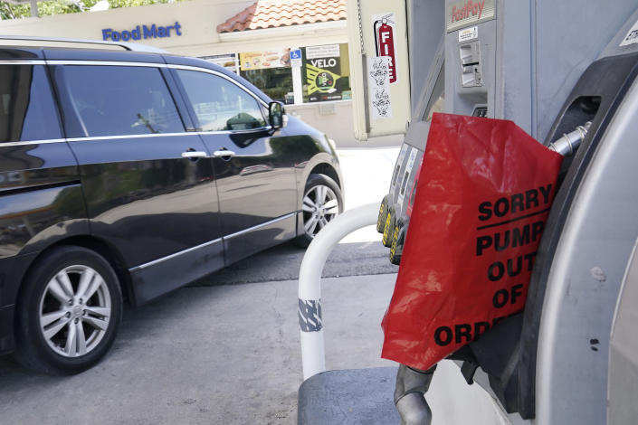 A customer drives from a Chevron station after it ran out of gasoline, Wednesday, May 12, 2021, in Miami. State and federal officials are scrambling to find alternate routes to deliver gasoline in the Southeast U.S. after a hack of the nation's largest fuel pipeline led to panic-buying that contributed to more than 1,000 gas stations running out of fuel. The pipeline runs from the Gulf Coast to the New York metropolitan region. (AP Photo/Marta Lavandier)