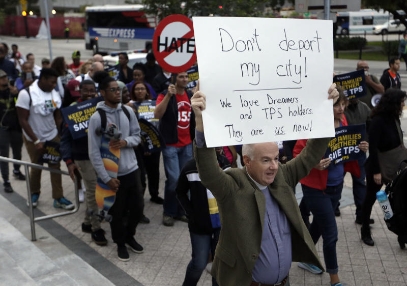 Frank Corbishley, of Coral Gables, Fla., marches in support of Deferred Action for Childhood Arrivals (DACA) and Temporary Protected Status (TPS) programs Wednesday, Jan. 17, 2018, in Miami. (AP Photo/Lynne Sladky)