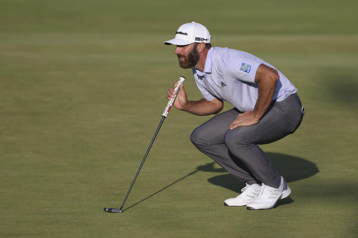 United States' Dustin Johnson looks at the line of his putt on the 18th green during the third round of the British Open Golf Championship at Royal St George's golf course Sandwich, England, Saturday, July 17, 2021. (AP Photo/Ian Walton)