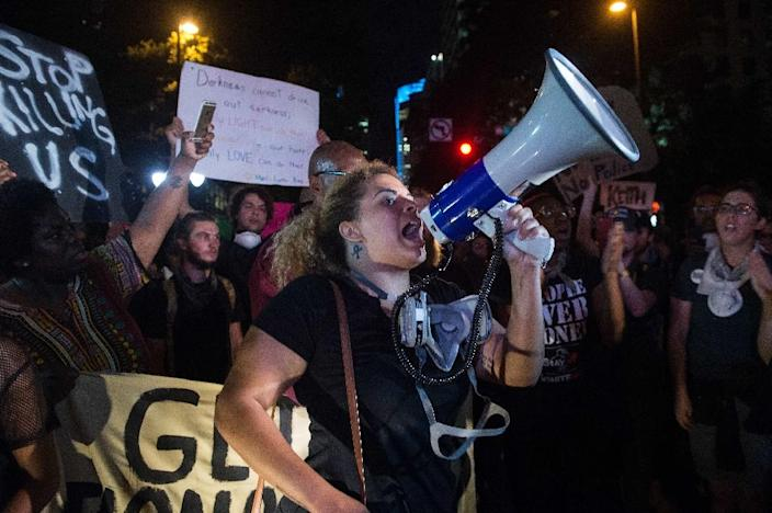 """Hundreds marched to the city police station in Charlotte, North Carolina, carrying signs saying """"Stop killing us"""" and """"Resistance is beautiful"""" (AFP Photo/Nicholas Kamm)"""