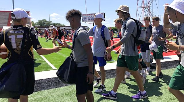 Trevor Lawrence goes full camp counselor in his bucket hat and purple Nikes. | Kalyn Kahler