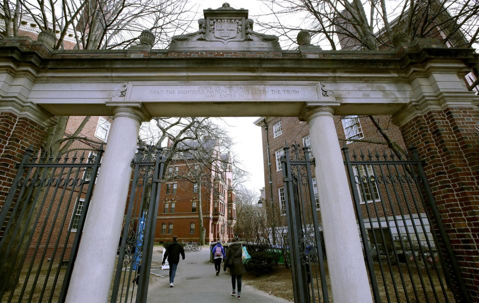 FILE - In this Dec. 13, 2018, file photo, a gate opens to the Harvard University campus in Cambridge, Mass. The U.S. Education Department said Wednesday, Feb. 12, 2020, it is investigating foreign gifts made to Harvard and Yale as part of a broader review of international money flowing to American universities. (AP Photo/Charles Krupa, File)