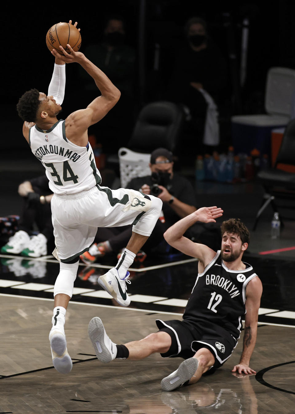 Milwaukee Bucks forward Giannis Antetokounmpo shoots over Brooklyn Nets forward Joe Harris (12) during the second half of Game 1 of an NBA basketball second-round playoff series Saturday, June 5, 2021, in New York. (AP Photo/Adam Hunger)