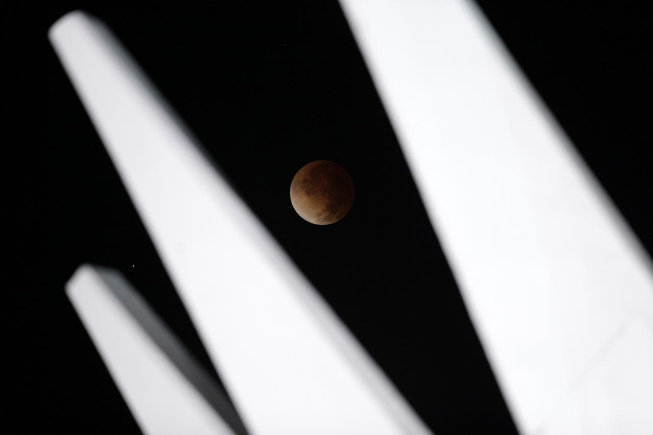 The moon is shown in eclipse in Brasilia April 15, 2014. The lunar eclipse on Tuesday will unfold over three hours when the moon begins moving into Earth's shadow. A little more than an hour later, the moon will be fully eclipsed and shrouded in an orange, red or brown glow. REUTERS / Ueslei Marcelino (BRAZIL - Tags: ENVIRONMENT SCIENCE TECHNOLOGY)