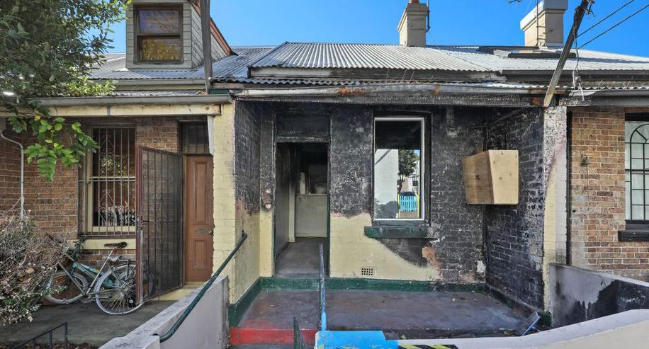A fire-bombed home in Campbell Street, Glebe is pictured.
