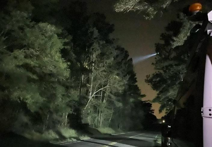 Law enforcement officials used helicopter search lights Wednesday night as they tracked a suspect in connection with a mass shooting near Rock Hill, S.C.