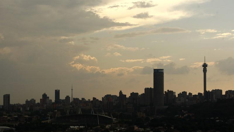 A silhouette of the city of Johannesburg is seen