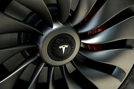A wheel of a  prototype of the Tesla Model 3 on display in front of the factory in Sparks