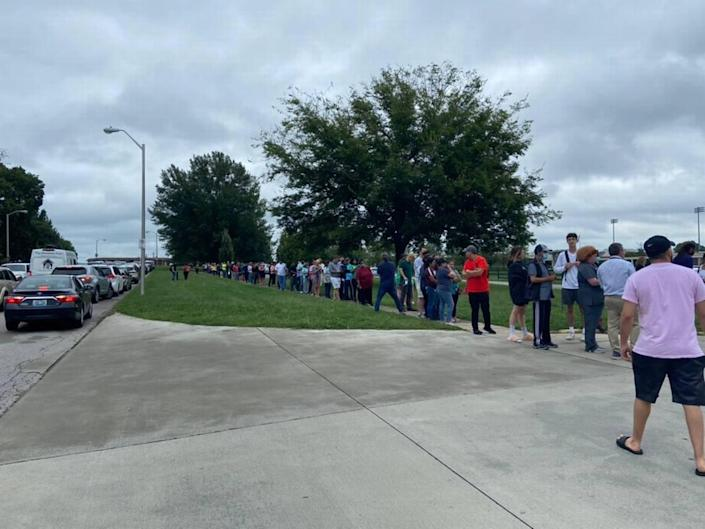 Parents at Henry Clay High School in Lexington waited in line to pick up their children after a bomb threat was made against four Fayette County schools Tuesday.