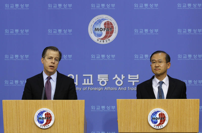 """U.S. Special Representative for North Korean Affairs Glyn Davies, left, answers reporters' questions as South Korean nuclear envoy Lim Sung-nam listens to him during a joint press conference at the Foreign Ministry in Seoul, South Korea, Saturday, Feb. 25, 2012. Davies who just finished nuclear talks with North Korean officials said ties between the rival Koreas must improve before Pyongyang and Washington can have a """"fundamental improvement"""" in their relationship. (AP Photo/Lee Jin-man)"""