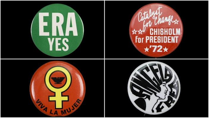 "Buttons in the Natural History Museum's 19th Amendment centennial exhibition, clockwise from top left: ""ERA YES"" from the 1960s or '70s; Shirley Chisholm's campaign button; a 1970s button supporting activist Angela Davis; and a 1960s button combining the Venus symbol with the Aztec Eagle logo of the United Farm Workers, co-founded by Dolores Huerta. <span class=""copyright"">(Natural History Museum of Los Angeles County)</span>"