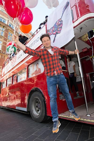 British chef and television personality Jamie Oliver promotes fresh, healthy and balanced meals for schools in the UK (AFP Photo/LEON NEAL, LEON NEAL)