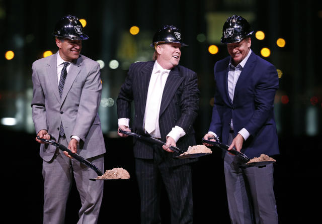 Raiders owner Mark Davis poses beside Nevada Gov. Brian Sandoval and NFL commissioner Roger Godell during a ceremonial groundbreaking for the Oakland Raiders' stadium in Las Vegas. (AP Photo)