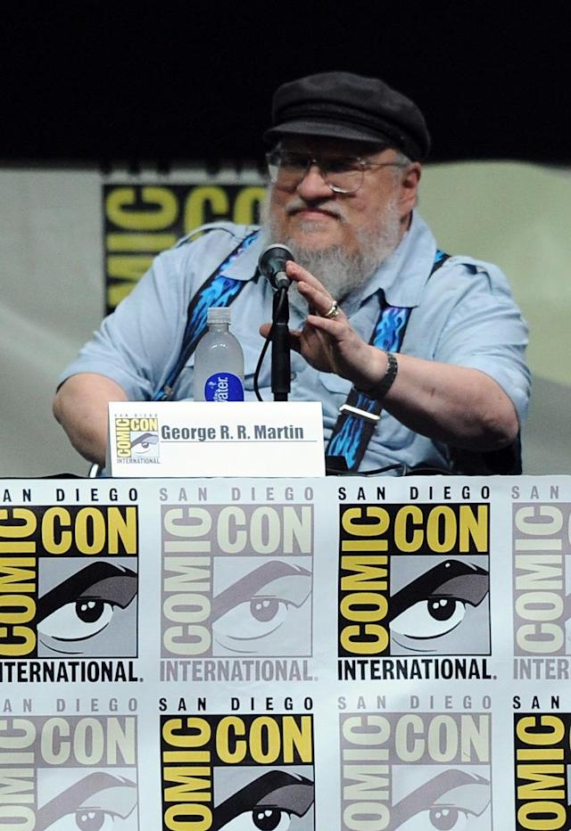 "Writer George R.R. Martin speaks onstage during the ""Game of Thrones"" panel at Comic-Con International 2013 at San Diego Convention Center on July 19, 2013 in San Diego, California."
