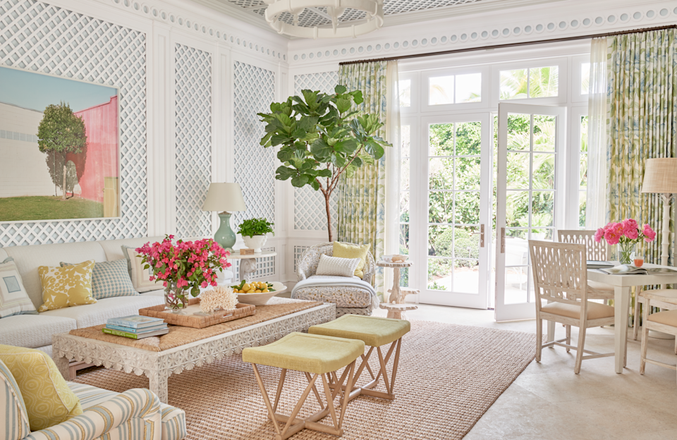 """<p>Palm Beach-based designer Phoebe Howard was tapped to bring a light, airy feel to this sweet getaway. The owners, two snowbirds escaping the cold Chicago winters, craved for their Florida home to burst with color and sunlight. A corner table from <a href=""""https://www.madegoods.com/"""" rel=""""nofollow noopener"""" target=""""_blank"""" data-ylk=""""slk:Made Goods"""" class=""""link rapid-noclick-resp"""">Made Goods</a> provides a place to gather in the latticed family room. </p><p><a class=""""link rapid-noclick-resp"""" href=""""https://www.veranda.com/decorating-ideas/g25422808/0064-0073-flight-of-fancy-january-2019/"""" rel=""""nofollow noopener"""" target=""""_blank"""" data-ylk=""""slk:Tour the Home"""">Tour the Home</a></p>"""