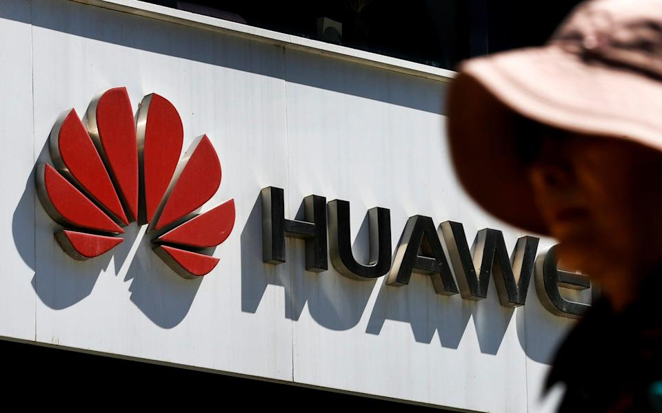 Huawei is selling its majority stake in an undersea cable business amid pressure from the US government - AP