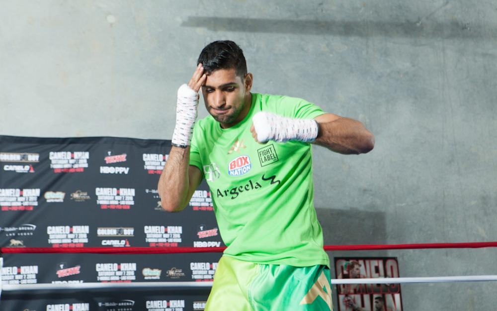 Amir Khan shadow boxes during an open media workout on April 18, 2016 in Hayward, California - Credit: Getty Images