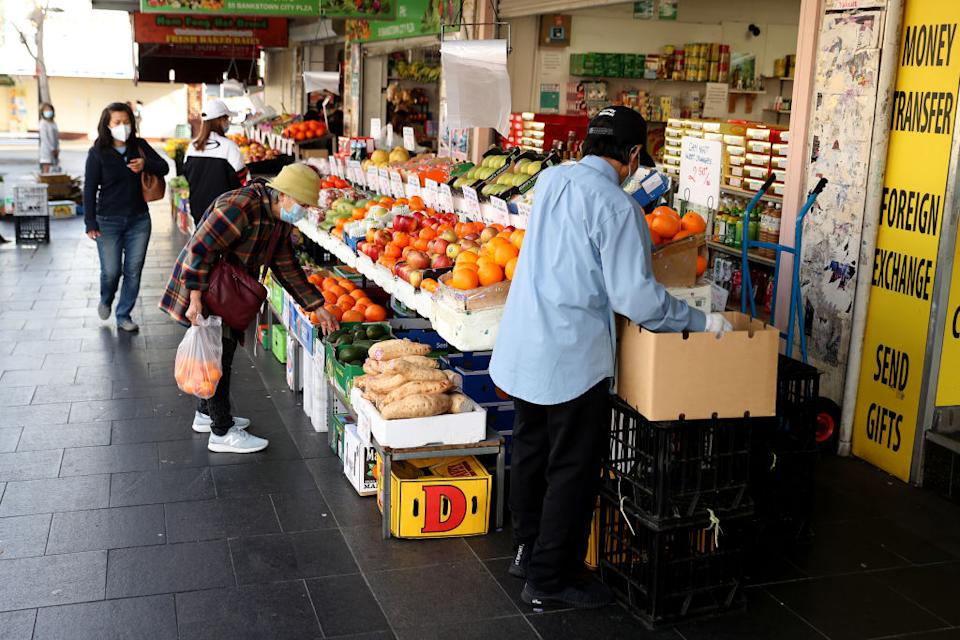 Customers shop for fresh produce at a store in the Bankstown surburb of Sydney, Australia.