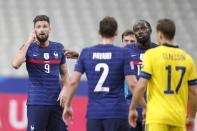 France's Olivier Giroud, left, reacts during the UEFA Nations League soccer match between France and Sweden at the Stade de France stadium in Saint-Denis, northern Paris, Tuesday, Nov. 17, 2020. (AP Photo/Francois Mori)
