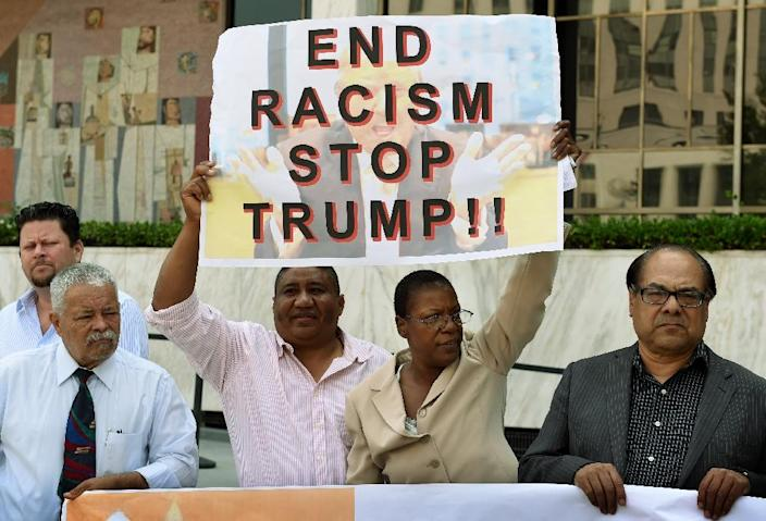 A coalition of Latino community leaders protest against the policies of Republican presidential hopeful Donald Trump, outside the Federal Building in Los Angeles, California on August 19, 2015 (AFP Photo/Mark Ralston)