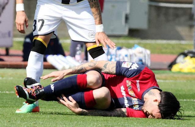 Rainbow coloured shoelaces are seen on Mauricio Pinilla's shoes as he grimaces in pain during an Italian Serie A soccer match between Cagliari and Udinese, in Cagliari, Italy, Sunday, March 2, 2014. More Serie A players are wearing rainbow-colored shoelaces this weekend in an expanding anti-homophobia demonstration. Cagliari midfielder Daniele Dessena received online attacks after wearing the laces last weekend and as a result three teammates _ South Americans Fernando Avelar, Victor Ibarbo and Mauricio Pinilla _ joined him in wearing the multi-colored laces for Sunday's match with Udinese. (AP Photo/Enrico Locci, Lapresse)
