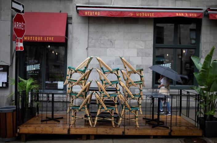FILE PHOTO: Chairs are stacked outside a bistro in Montreal
