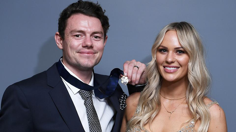 Lachie Neale is pictured his wife Julie after winning the 2020 Brownlow Medal.
