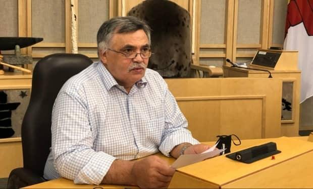 Nunavut's Health Minister Lorne Kusugak said public health was reviewing the essential worker program to see if there are any changes the government can make to improve the program.  (Jackie McKay/CBC News - image credit)