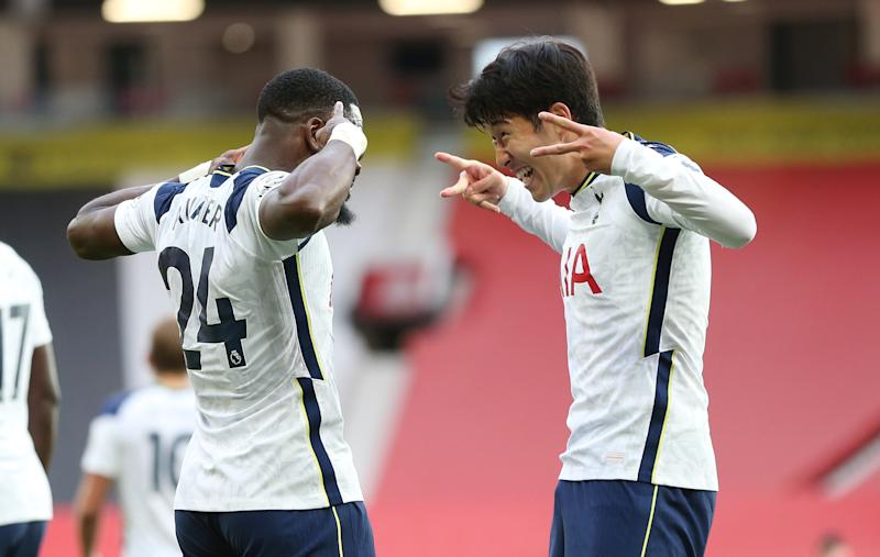 MANCHESTER, ENGLAND - OCTOBER 04: Heung-Min Son of Tottenham Hotspur celebrates after scoring their fourth goal with Serge Aurier during the Premier League match between Manchester United and Tottenham Hotspur at Old Trafford on October 04, 2020 in Manchester, England. Sporting stadiums around the UK remain under strict restrictions due to the Coronavirus Pandemic as Government social distancing laws prohibit fans inside venues resulting in games being played behind closed doors. (Photo by Tottenham Hotspur FC/Tottenham Hotspur FC via Getty Images)