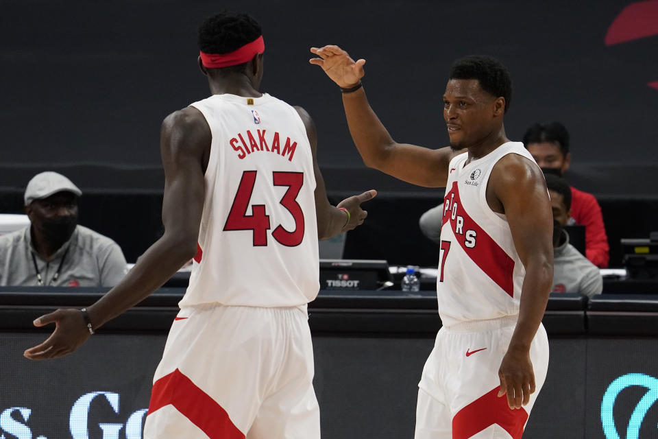 Toronto Raptors guard Kyle Lowry (7) celebrates with forward Pascal Siakam (43) as the pair is taken out of the game against the Denver Nuggets during the second half of an NBA basketball game Wednesday, March 24, 2021, in Tampa, Fla. (AP Photo/Chris O'Meara)