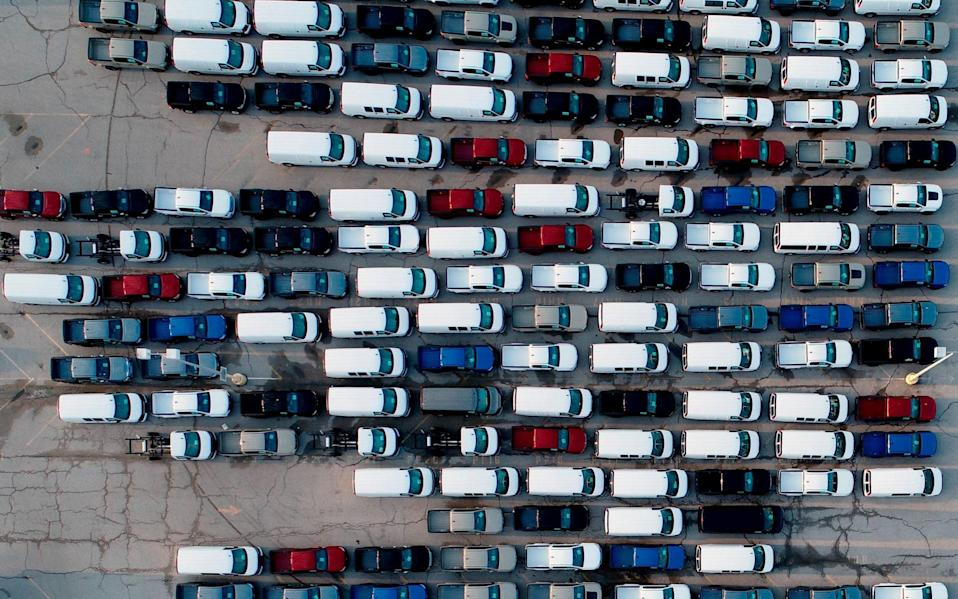 Trucks parked outside a car factory in the US - AP Photo/Jeff Roberson