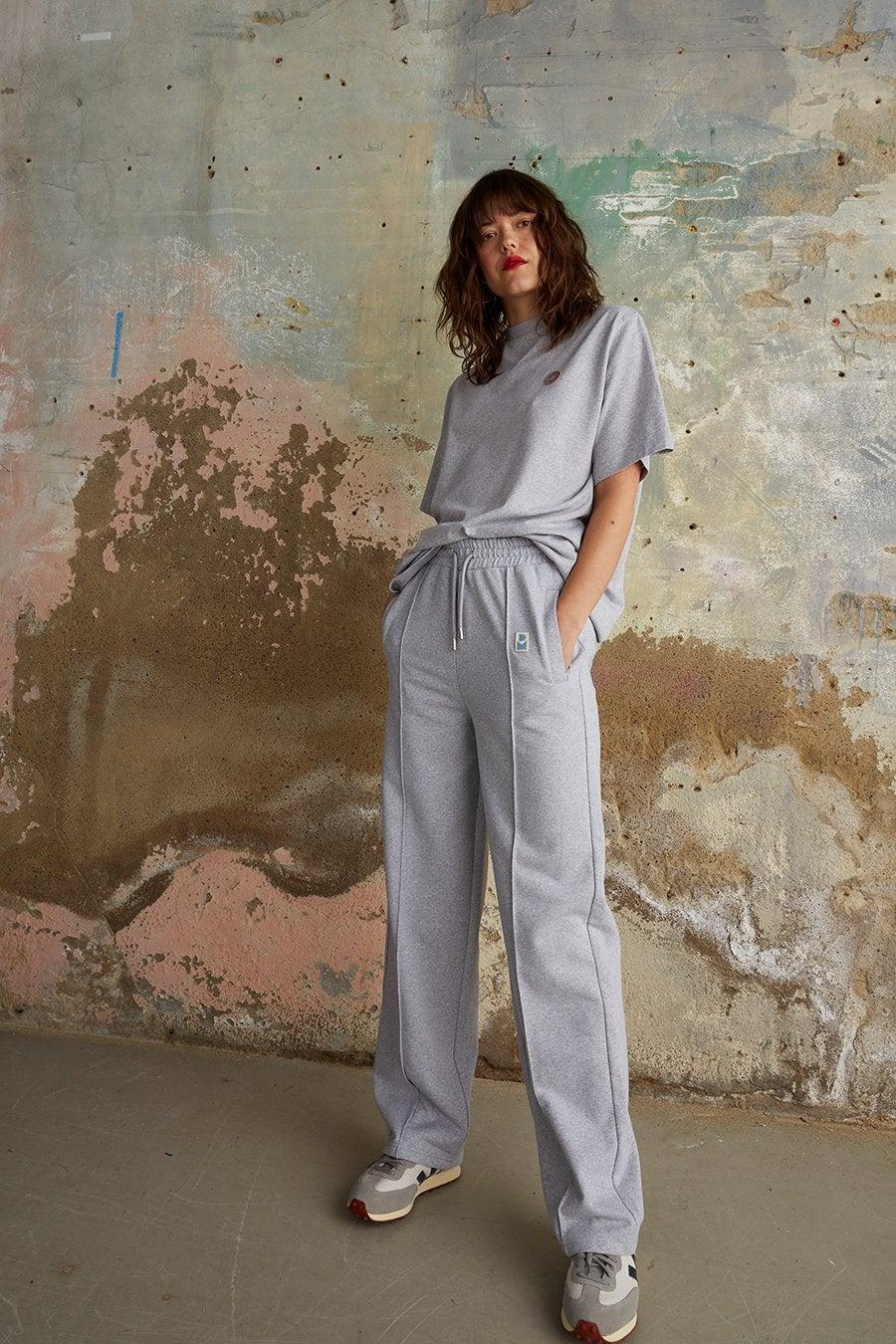 """<br><br><strong>Damson Madder</strong> Straight Leg Drawstring Joggers in Grey, $, available at <a href=""""https://damsonmadder.com/collections/new-in/products/straight-leg-relaxed-trousers-grey"""" rel=""""nofollow noopener"""" target=""""_blank"""" data-ylk=""""slk:Damson Madder"""" class=""""link rapid-noclick-resp"""">Damson Madder</a>"""
