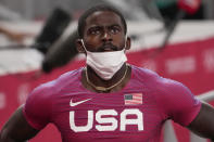 Trayvon Bromell, of United States, finishes a heat in the men's 100-meter run at the 2020 Summer Olympics, Saturday, July 31, 2021, in Tokyo. (AP Photo/Charlie Riedel)