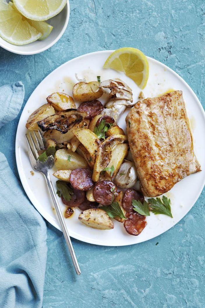 """<p>Fish and sausage are the unlikely pairing you're about to fall for thanks to this 30-minute meal.</p><p><em><a href=""""https://www.womansday.com/food-recipes/food-drinks/recipes/a54000/roasted-cod-potatoes-and-chorizo-recipe/"""" rel=""""nofollow noopener"""" target=""""_blank"""" data-ylk=""""slk:Get the Roasted Cod, Potatoes, and Chorizo recipe."""" class=""""link rapid-noclick-resp"""">Get the Roasted Cod, Potatoes, and Chorizo recipe.</a></em></p>"""