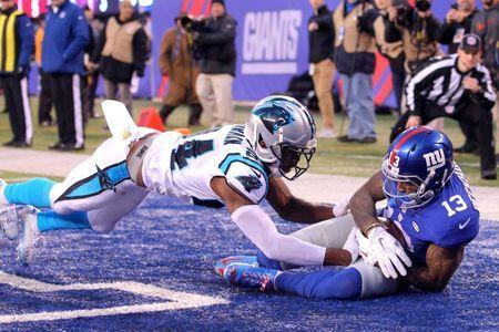 Dec 20, 2015; East Rutherford, NJ, USA; New York Giants wide receiver Odell Beckham Jr. (13) catches a touchdown pass in front of Carolina Panthers corner back Josh Norman (24) during the fourth quarter at MetLife Stadium. The Panthers defeated the Giants 38-35. Mandatory Credit: Brad Penner-USA TODAY Sports