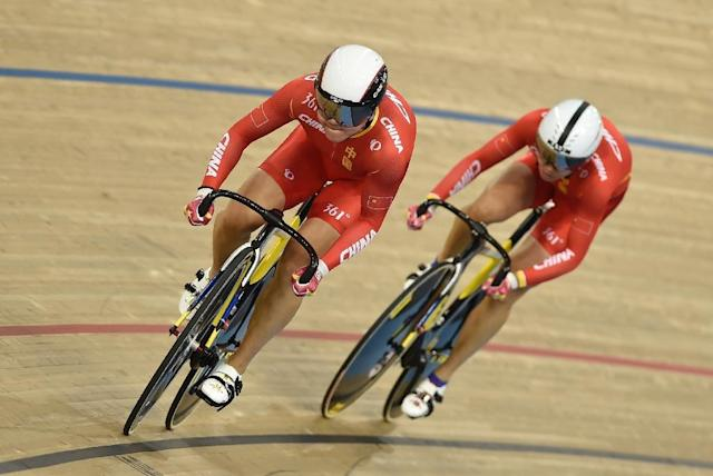 China's Jinjie Gong and Tianshi Zhong compete in the Women's team sprint qualification during the 2016 Track Cycling World Championships at the Lee Valley VeloPark in London on March 2, 2016 (AFP Photo/Eric Feferberg)