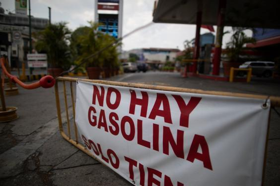 """A banner reads """"there is no gasoline"""" outside a closed fuel station in Caracas, Venezuela (AP)"""