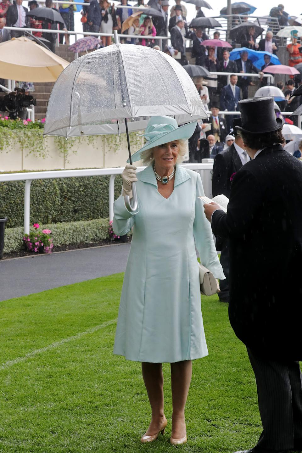The Duchess of Cornwall looked elegant in an aqua long-sleeved dress with a matching hat, nude accessories and her aquamarine three-strand pearl necklace. <em>[Photo: Getty]</em>