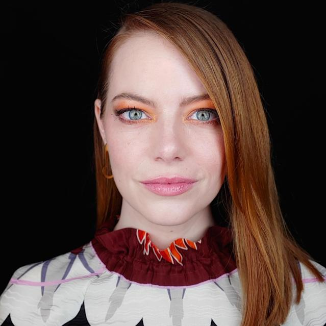 "Don't let anyone ever tell you a redhead can't wear orange eye shadow. For the BAFTA Tea Party, <a href=""https://www.allure.com/topic/emma-stone?mbid=synd_yahoo_rss"" rel=""nofollow noopener"" target=""_blank"" data-ylk=""slk:Emma Stone"" class=""link rapid-noclick-resp"">Emma Stone</a> wore a bright, sunny shade all over her lids with gradient shades of gold and bronze fully lining each eye. The rest of her makeup was kept simple, with a barely there soft, pink shine on her lips."