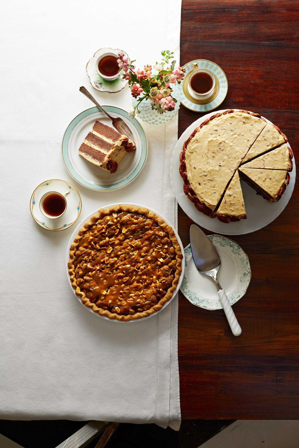 """<p>The salted caramel and peanut butter topping on this pie makes this a dessert no one will forget!</p><p><strong><a href=""""https://www.countryliving.com/food-drinks/recipes/a5906/salted-caramel-peanut-butter-fudge-pie-recipe-clx1114/"""" rel=""""nofollow noopener"""" target=""""_blank"""" data-ylk=""""slk:Get the recipe"""" class=""""link rapid-noclick-resp"""">Get the recipe</a>.</strong> </p>"""