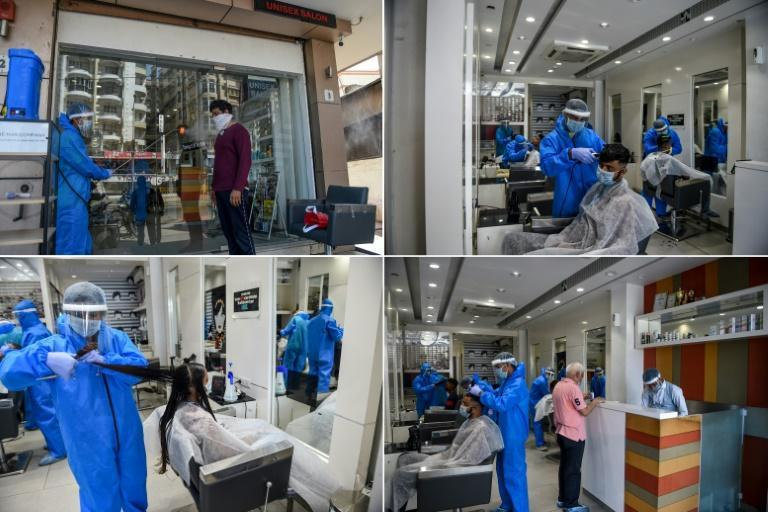 India has extended its nationwide anti-virus lockdown until May 31, 2020, but in some areas like Nadiad, some businesses are open under strict conditions, like this hair salon, where workers spray disinfectant and check temperatures