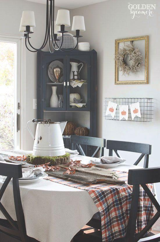"""<p>A vintage white enamel pitcher perched on top of a mossy wood slice takes center stage on this blogger's Thanksgiving table. </p><p><strong>Get the tutorial at <a href=""""http://www.thegoldensycamore.com/2014/11/fall-tablescape-embroidered-napkins.html"""" rel=""""nofollow noopener"""" target=""""_blank"""" data-ylk=""""slk:The Golden Sycamore"""" class=""""link rapid-noclick-resp"""">The Golden Sycamore</a>.</strong></p><p><strong><strong><a class=""""link rapid-noclick-resp"""" href=""""https://www.amazon.com/Elanze-Designs-Decorative-Pumpkins-Quantity/dp/B07CHVVC1S?tag=syn-yahoo-20&ascsubtag=%5Bartid%7C10050.g.2130%5Bsrc%7Cyahoo-us"""" rel=""""nofollow noopener"""" target=""""_blank"""" data-ylk=""""slk:SHOP FAUX WHITE PUMPKINS"""">SHOP FAUX WHITE PUMPKINS</a></strong><br></strong></p>"""