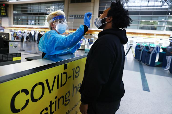 A man receives a nasal swab COVID-19 test at Tom Bradley International Terminal at Los Angeles International Airport (LAX) amid a coronavirus surge in Southern California on December 22, 2020 in Los Angeles, California. (Mario Tama/Getty Images)