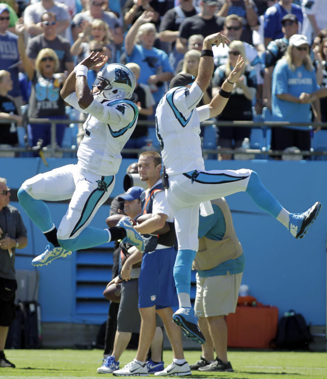 Carolina Panthers quarterback Cam Newton, left, and Derek Anderson, right, celebrate a touchdown against the New York Giants during the first half of an NFL football game in Charlotte, N.C., Sunday, Sept. 22, 2013. (AP Photo/Bob Leverone)