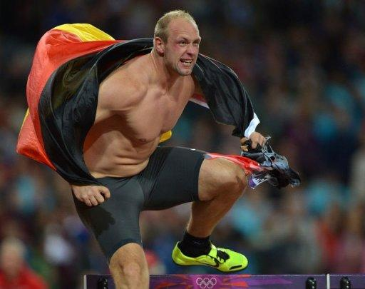 Germany's Robert Harting celebrates after winning the men's discus throw final at the athletics event during the London 2012 Olympic Games in London
