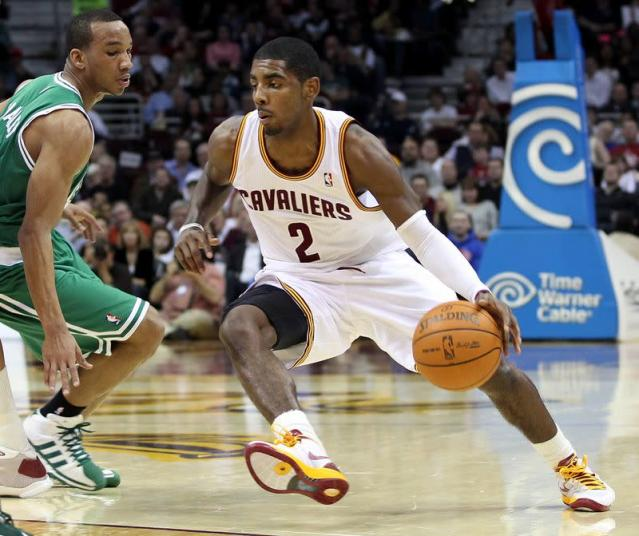 Cavaliers' Irving dribbles around Celtics' Bradley during the second quarter of their NBA basketball game in Cleveland