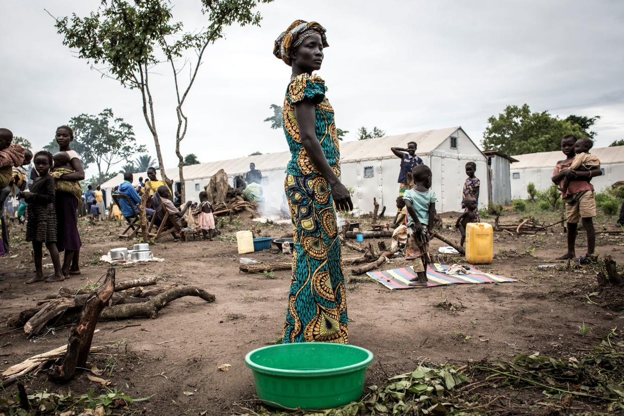 A refugee stands in a settlement camp in the Congo after arriving the night before from South Sudan. (Photo: John Wessels/AFP via Getty Images)