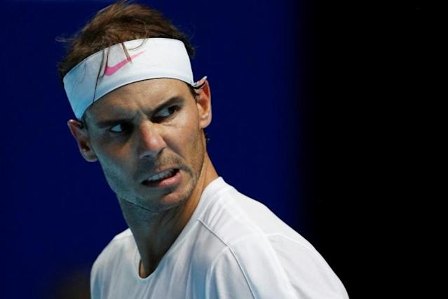 Spain's Rafael Nadal is guaranteed to finish the year as the world number one (AFP Photo/Adrian DENNIS)