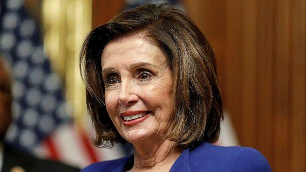 PHOTO: House Speaker Nancy Pelosi hosts a signing ceremony after the House of Representatives approved a $2.2 trillion coronavirus aid package at the U.S. Capitol, in Washington, March 27, 2020.  (Tom Brenner/Reuters)